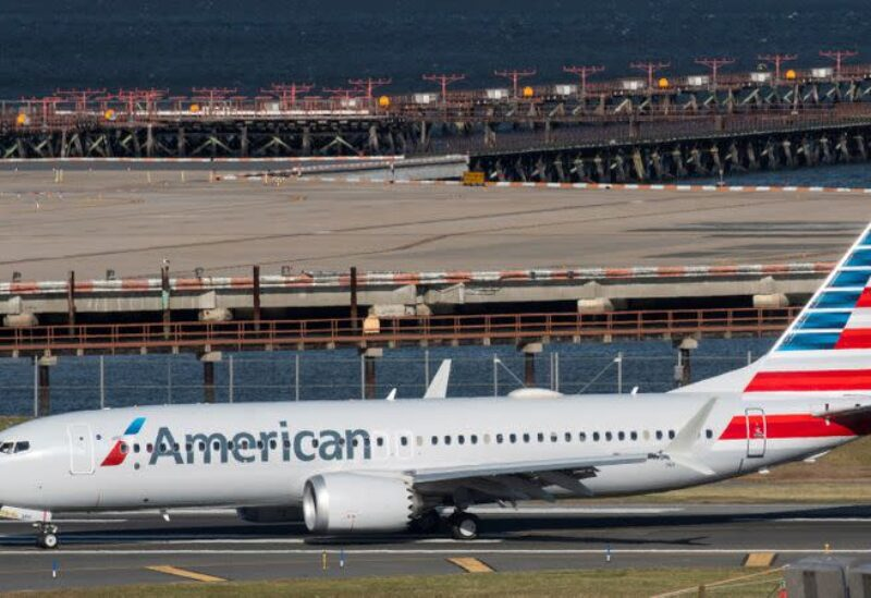 FILE PHOTO: American Airlines flight 718, the first U.S. Boeing 737 MAX commercial flight since regulators lifted a 20-month grounding in November, lands at LaGuardia airport in New York, U.S. December 29, 2020.