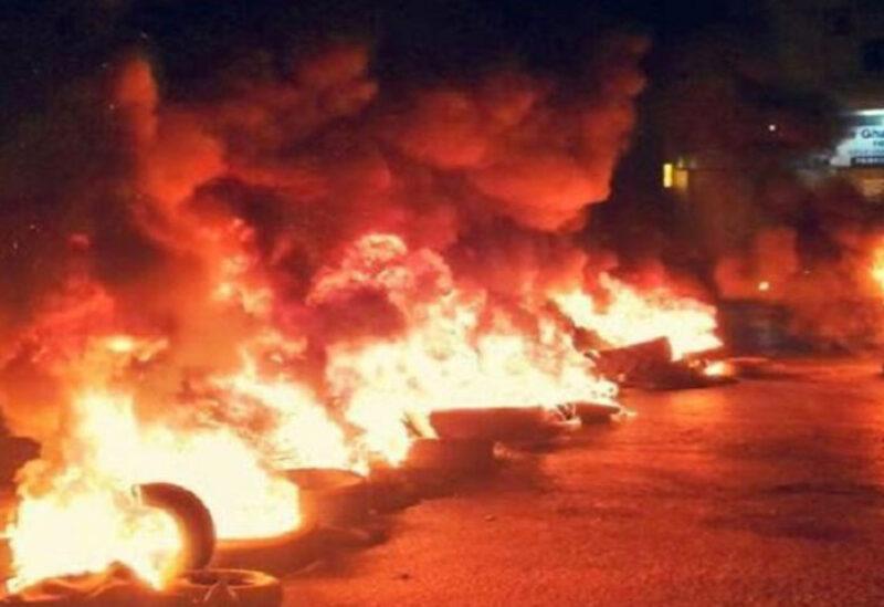 Protesters burn tires amid unprecedented surge in dollar