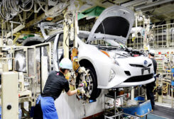 Toyota to cut production