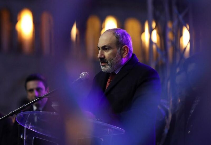 FILE PHOTO: Armenian Prime Minister Nikol Pashinyan delivers a speech during a rally held by his supporters in Republic Square in Yerevan, Armenia March 1, 2021.