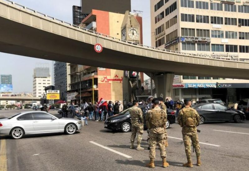 FILE PHOTO: Cars block a highway during a protest against the fall in Lebanese pound currency and mounting economic hardships, in Jal el-Dib, Lebanon March 9, 2021.