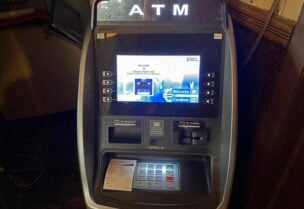 FILE PHOTO: A LibertyX Bitcoin ATM is seen at the Grassy Point Bar & Grill in Broad Channel, New York, U.S. March 8, 2021.