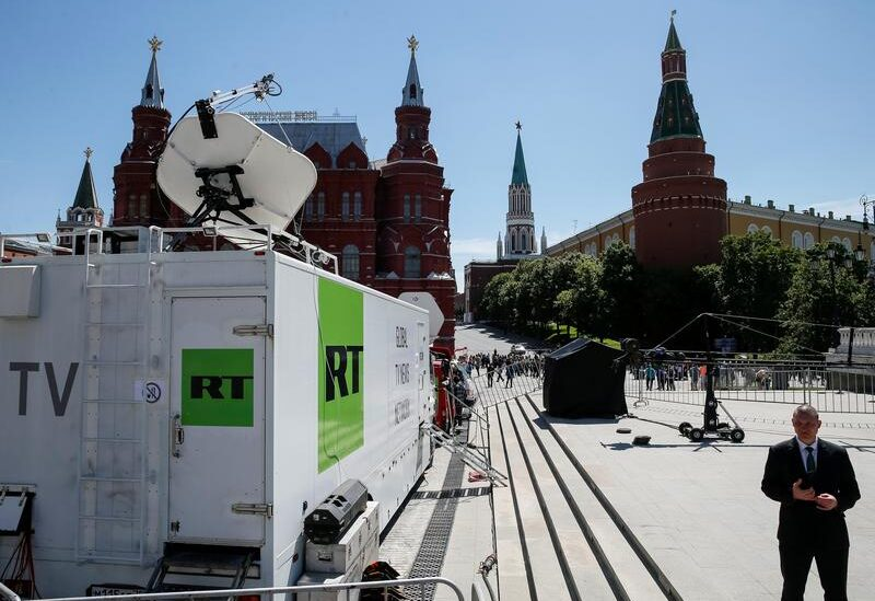 FILE PHOTO: Vehicles of Russian state-controlled broadcaster Russia Today (RT) are seen near the Red Square in Central Moscow, Russia, June 15, 2018.