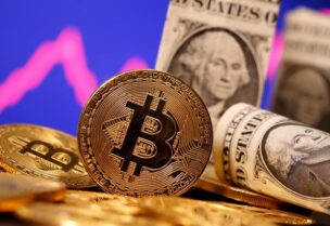 FILE PHOTO: A representation of virtual currency Bitcoin and U.S. One Dollar banknotes are seen in front of a stock graph in this illustration taken January 8, 2021.