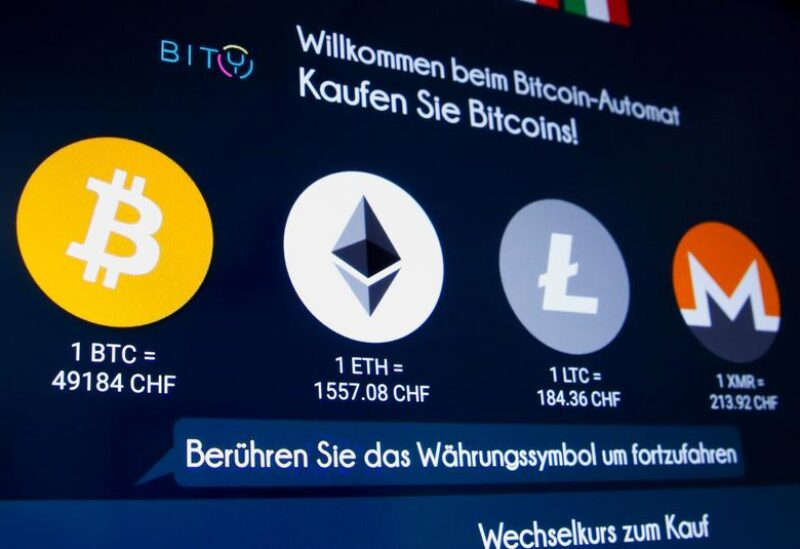 The exchange rates and logos of Bitcoin (BTH), Ether (ETH), Litecoin (LTC) and Monero (XMR) are seen on the display of a cryptocurrency ATM of blockchain payment service provider Bity at the House of Satochi bitcoin and blockchain shop in Zurich, Switzerland March 4, 2021.