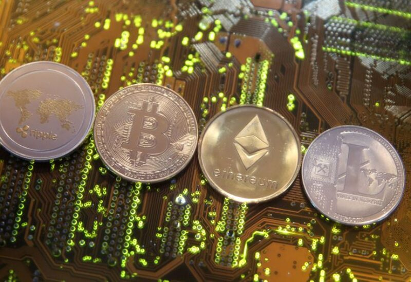 FILE PHOTO: Representations of the Ripple, Bitcoin, Etherum and Litecoin virtual currencies are seen on a PC motherboard in this illustration picture, February 13, 2018. Picture is taken February 13, 2018.