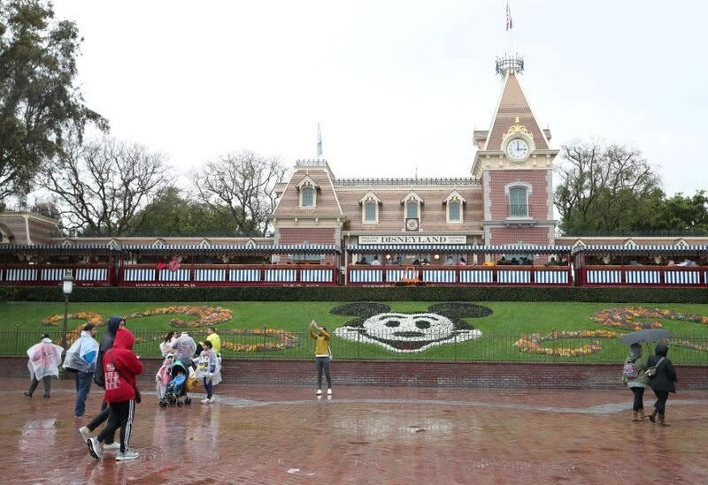 FILE PHOTO: A general view of the entrance of Disneyland theme park in Anaheim, California, U.S., March 13, 2020.