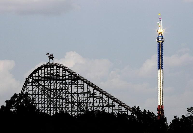 FILE PHOTO: The Texas Giant roller coaster ride (L) is seen at the Six Flags Over Texas amusement park in Arlington, Texas July 23, 2013.