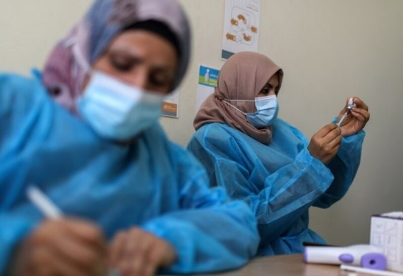 A health worker prepares a vaccination against the coronavirus disease, in Gaza City March 17, 2021.