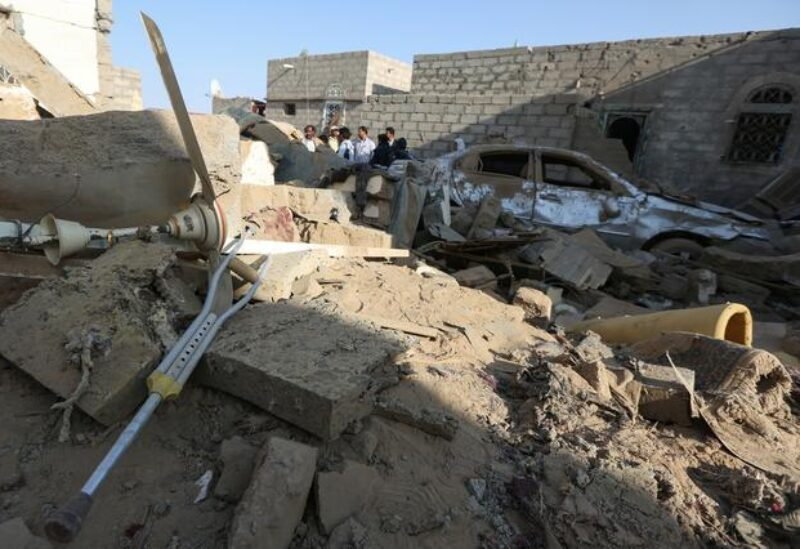FILE PHOTO: People stand at the site of a Houthi ballistic missile attack over the populated district of Rawda in Marib, Yemen February 6, 2020.