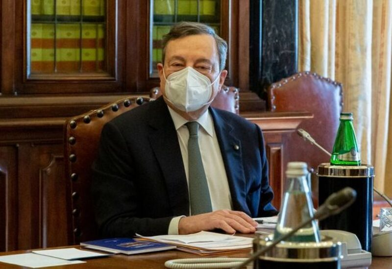 FILE PHOTO: Italy's Prime Minister designate Mario Draghi looks on during the second round of his talks on forming a new government, in Rome, Italy, February 9, 2021.
