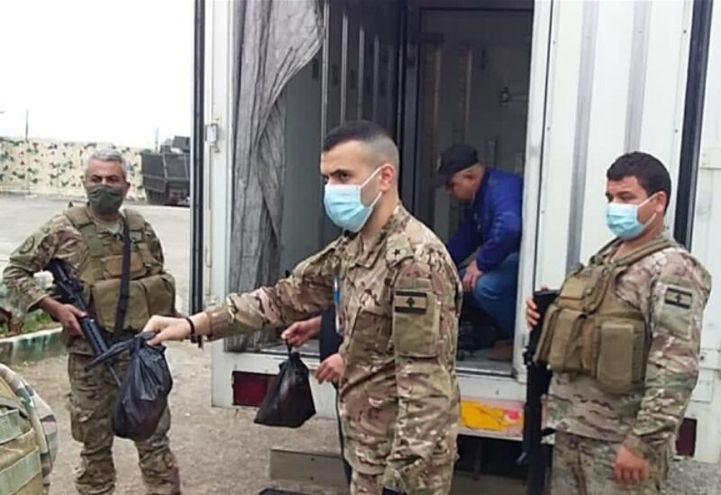 A picture showing Lebanese army units distributing foodstuffs to the families in need in the northern city of Tripoli on March 22, 2021.