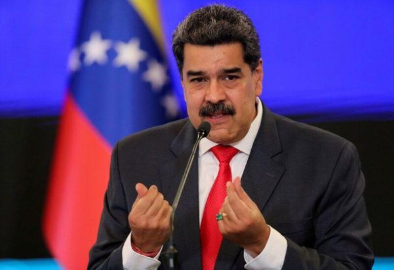 FILE PHOTO: Venezuelan President Nicolas Maduro gestures as he speaks during a news conference in Caracas, Venezuela, December 8, 2020.