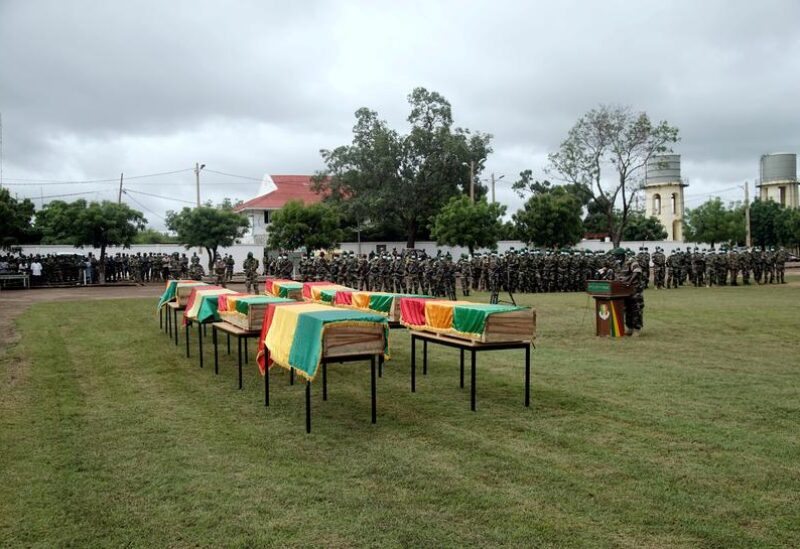 FILE PHOTO: A view of flag-draped coffins of Malian soldiers, that the army said were killed in militant attacks in Gueri town, during an honour ceremony at the army headquarters in Kati, Mali September 6, 2020.