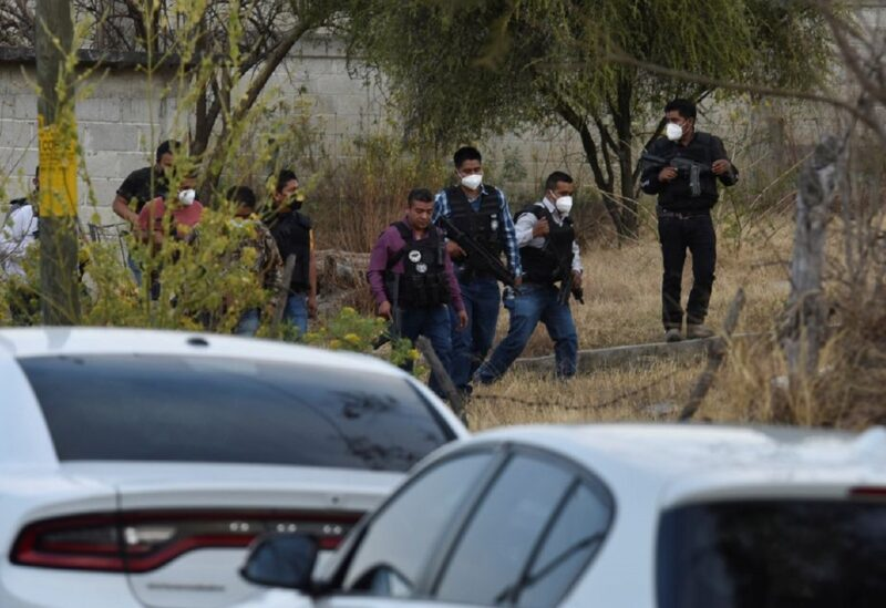 Police officers work at a crime scene where gunmen killed at least 13 Mexican police officers in an ambush, in Coatepec Harinas, Mexico March 18, 2021.
