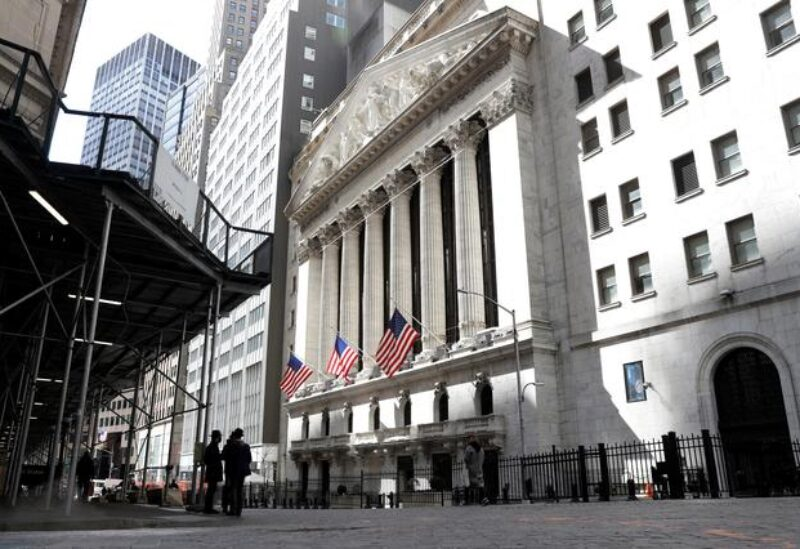 FILE PHOTO: People are seen on Wall St. outside the New York Stock Exchange (NYSE) in New York City, U.S., March 19, 2021.