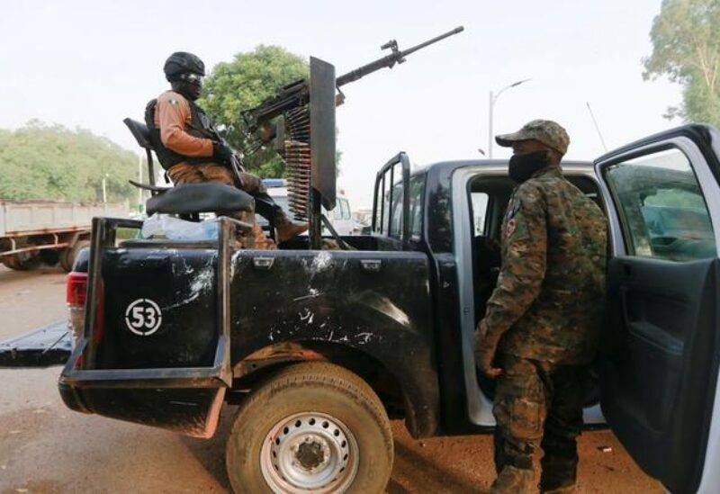 FILE PHOTO: A soldier sits on one of the trucks used to bring back the girls who were kidnapped from a boarding school in the northwest Nigerian state of Zamfara, following their release in Zamfara, Nigeria, March 2, 2021.