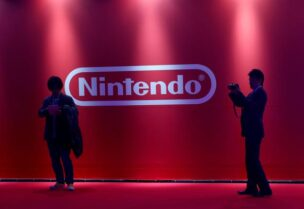 FILE PHOTO: People stand in front of Nintendo's logo in Tokyo, Japan January 13, 2017.