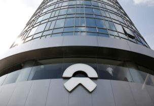 FILE PHOTO: A logo of the electric vehicle maker NIO is seen at its store in Beijing, China August 20, 2020.