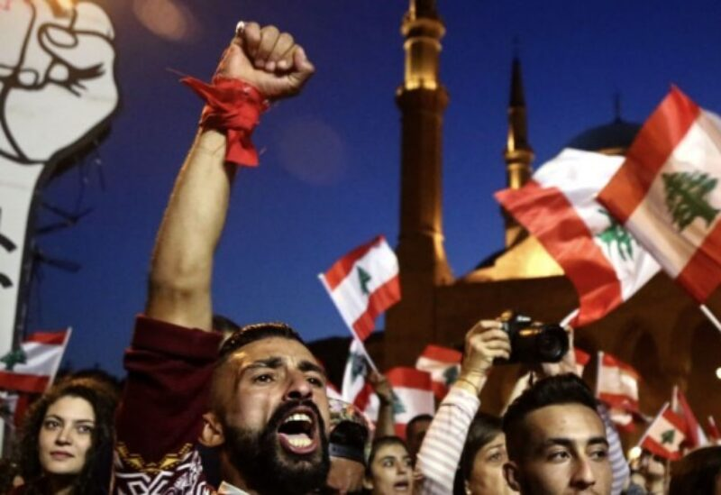 Protesters wave Lebanese flag near Beirut's Al Amin mosque