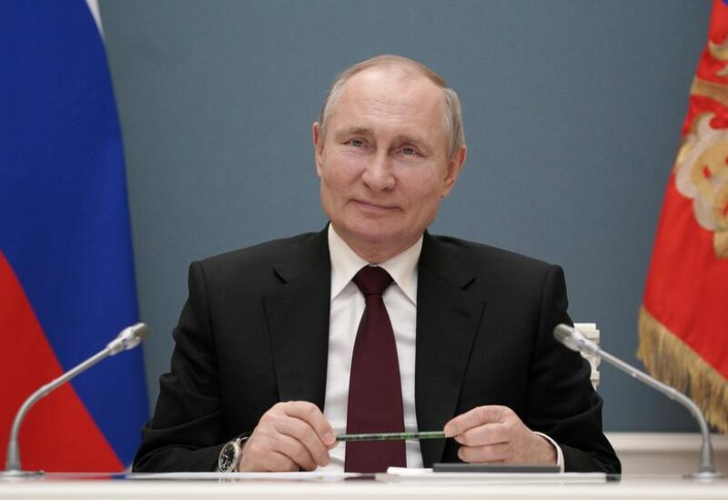 FILE PHOTO: Russian President Vladimir Putin takes part in a ceremony launching the Talas Gold Mining Plant at Kyrgyzstan's Jerooy gold deposit via a video link in Moscow, Russia March 17, 2021.
