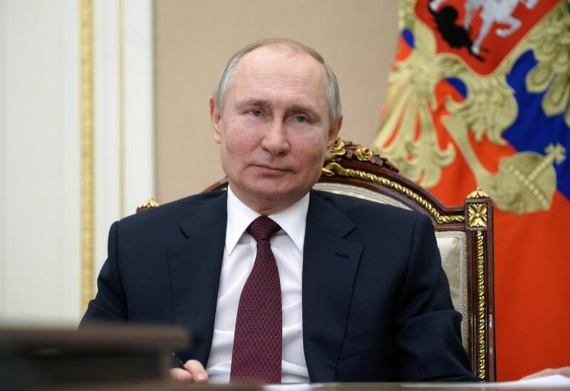 FILE PHOTO: Russian President Vladimir Putin takes part in a meeting with community representatives and residents of Crimea and Sevastopol via a video link in Moscow, Russia March 18, 2021.