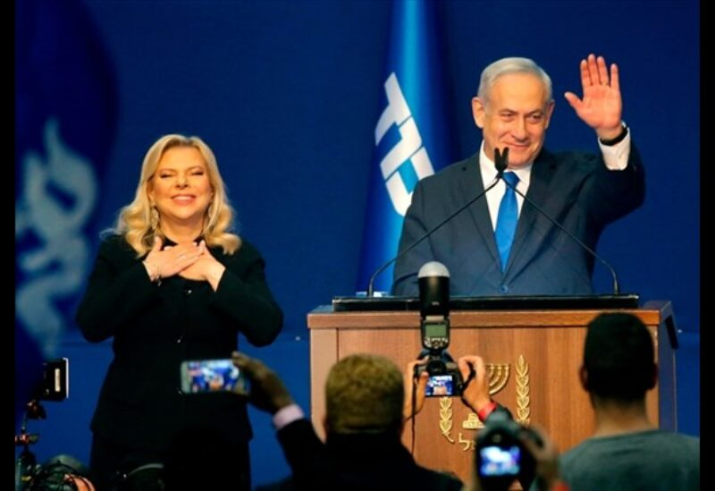 Israeli Prime Minister Benjamin Netanyahu and his wife Sara address supporters at the Likud party campaign headquarters in the coastal city of Tel Aviv early on March 3, 2020, after polls officially closed.