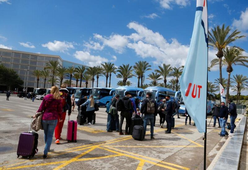 FILE PHOTO: Tourists from Germany arrive at Palma de Mallorca Airport following Berlin's lifted quarantine requirement for travellers returning from the Balearic Islands amid the coronavirus disease (COVID-19) pandemic, Palma de Mallorca, Spain March 21, 2021.