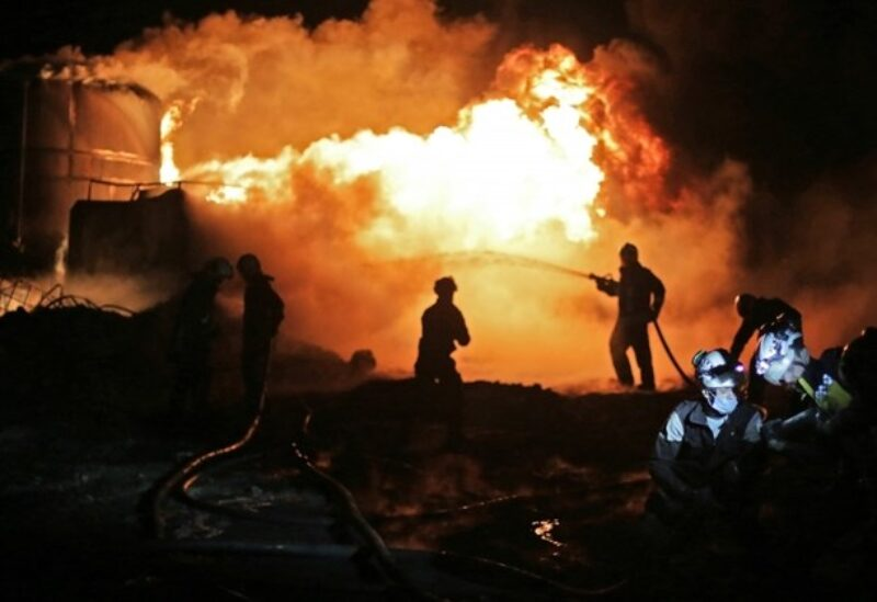 Members of Syrian Civil Defense (White Helmets) extinguish fire which reportedly erupted after bombardment in Syria