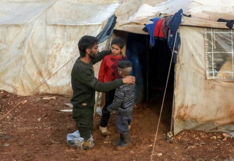 A family of Syrian nationals living in a tent.