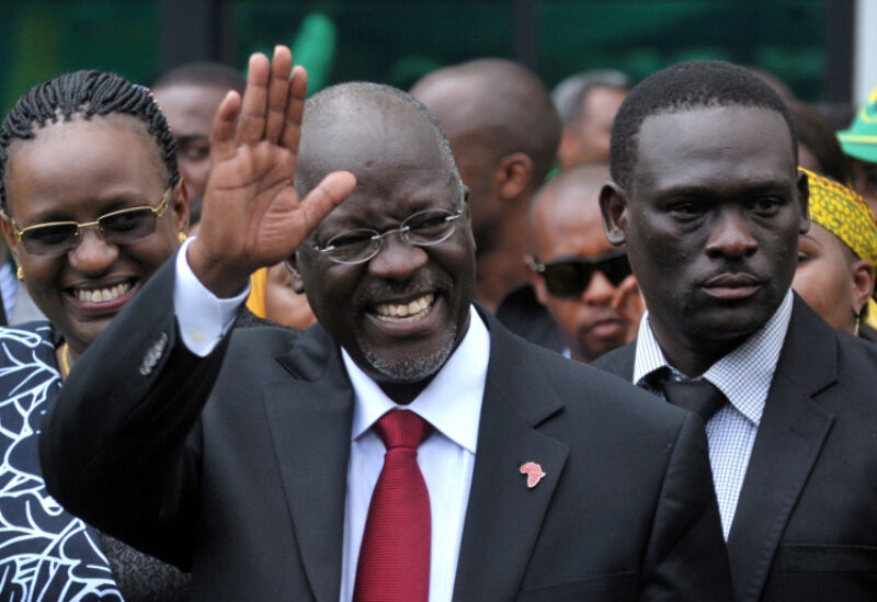 FILE PHOTO: Tanzania's President elect John Magufuli salutes members of the ruling Chama Cha Mapinduzi Party (CCM) at the party's sub-head office on Lumumba road in Dar es Salaam, October 30, 2015.