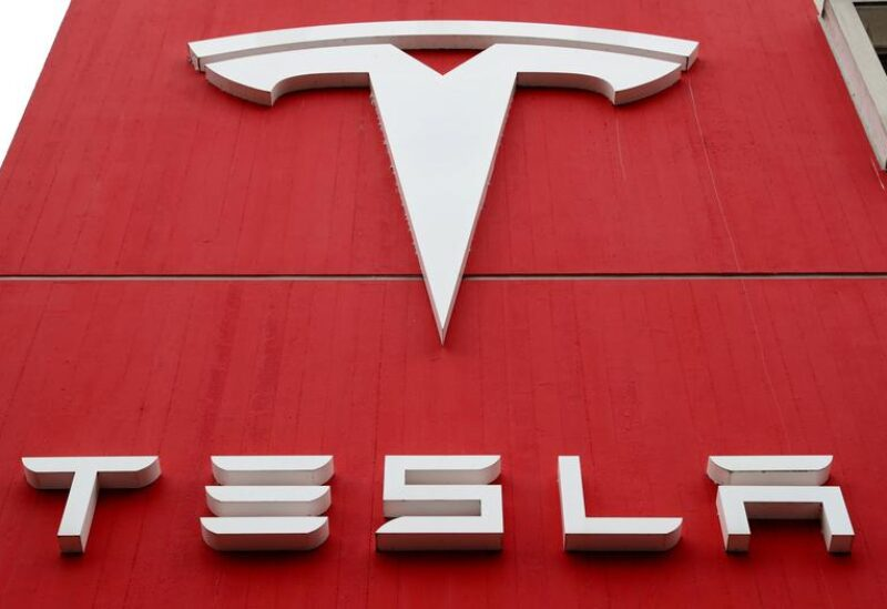 FILE PHOTO: The logo of car manufacturer Tesla is seen at a branch office in Bern, Switzerland October 28, 2020.