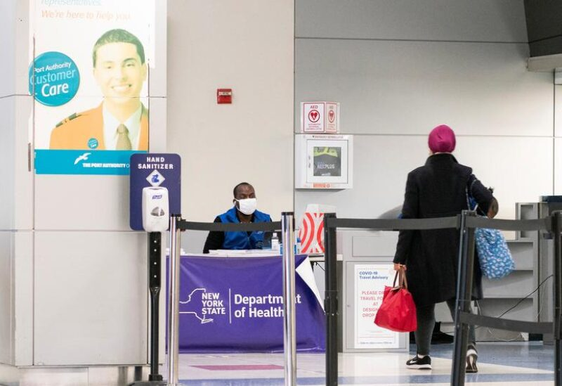 FILE PHOTO: Passengers arrive on a flight from London amid new restrictions to prevent the spread of coronavirus disease (COVID-19) at JFK International Airport in New York City, U.S., December 21, 2020.