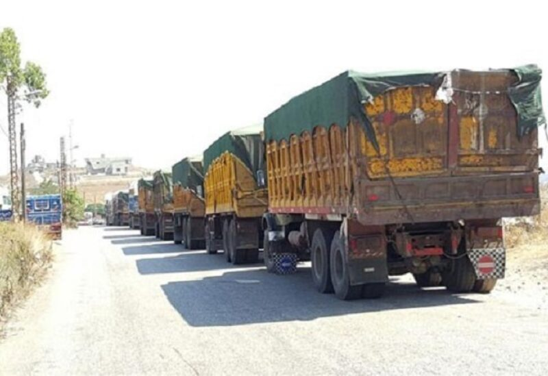 FILE PHOTO: Trucks smuggling goods en route to Syria.