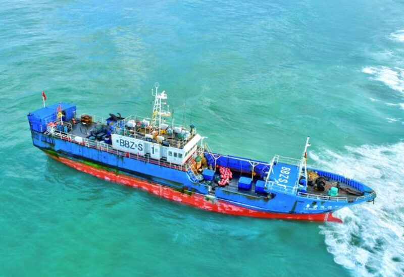 A Chinese-flagged trawler that ran aground containing 130 tonnes of oil, is seen in the Indian Ocean waters at Pointe Aux Sables, on the western coast of the island of Mauritius, March 8, 2021.