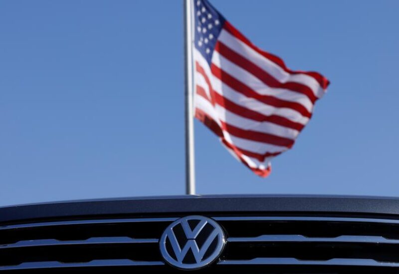 FILE PHOTO: A Volkswagen logo is shown with an American flag at a car dealership in Carlsbad, California, U.S., September 23, 2020.