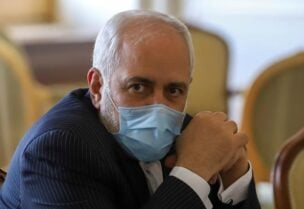 FILE PHOTO: Iran's Foreign Minister Mohammad Javad Zarif looks on during a meeting with International Atomic Energy Agency (IAEA) Director General Rafael Grossi in Tehran, Iran February 21, 2021.