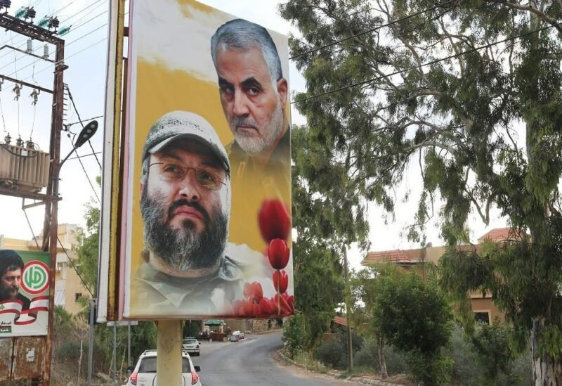 A poster depicting assassinated Hezbollah military commander Imad Mughniyeh and the late Iran's Quds Force top commander Qassem Soleimani in Ain Qana, Lebanon, Sept. 22, 2020. (Reuters)