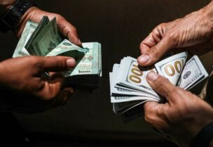 People exchange Lebanese pound and dollar notes on the black market in Beirut