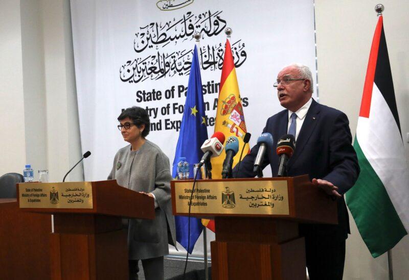 Spanish Foreign Minister Arancha Gonzalez Laya and her Palestinian counterpart Riyad Al-Maliki