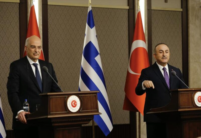 Turkish Foreign Minister Mevlut Cavusoglu and Greek Foreign Minister Nikos Dendias