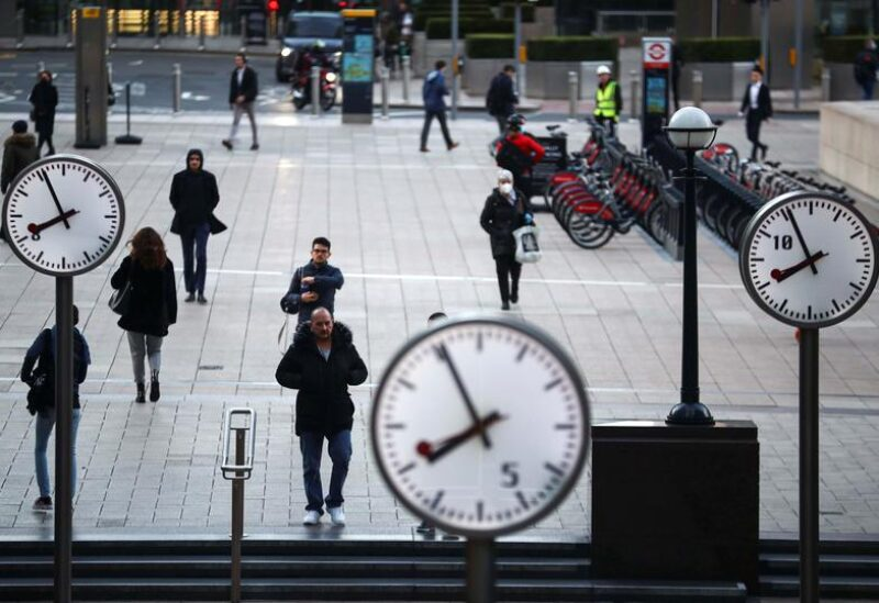 FILE PHOTO: People walk during the morning rush hour in the Canary Wharf amid the outbreak of the coronavirus disease (COVID-19) in London Britain, October 15, 2020.