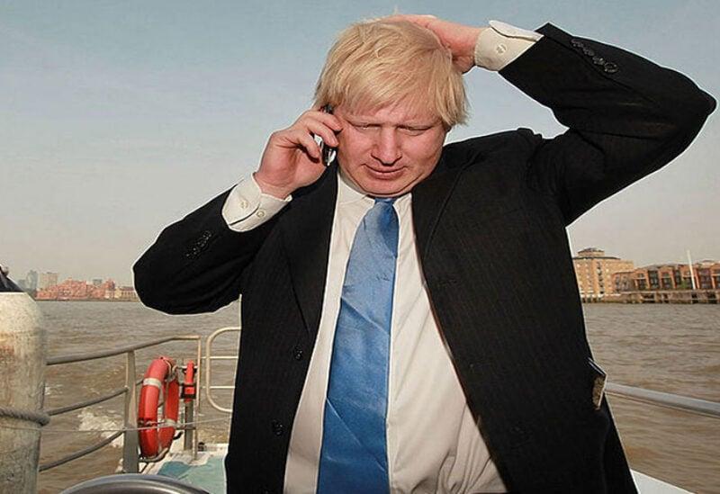 UK Prime Minister Boris Johnson talking on his mobile phone