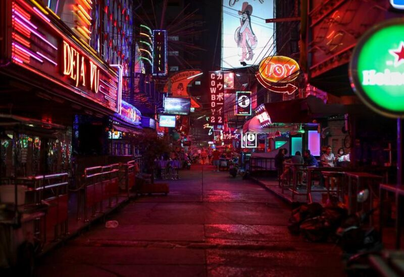 FILE PHOTO: Night clubs and go-go bars street Soi Cowboy is seen empty after Thai government ordered the closure of cinemas, bars and other entertainment facilities as part of a raft of measures intended to control the spread of the coronavirus disease (COVID-19) outbreak in Bangkok, Thailand March 18, 2020.