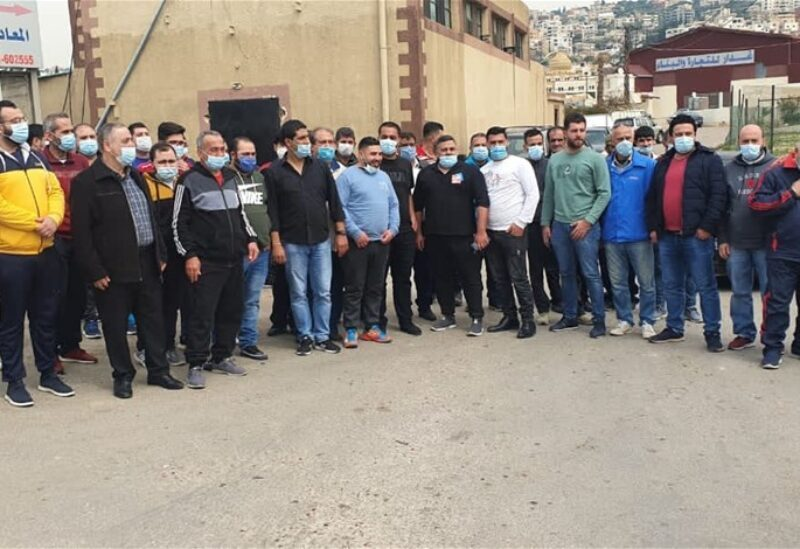Butcher shop owners staging a sit-in outside the slaughterhouse of Al Ghaziyeh