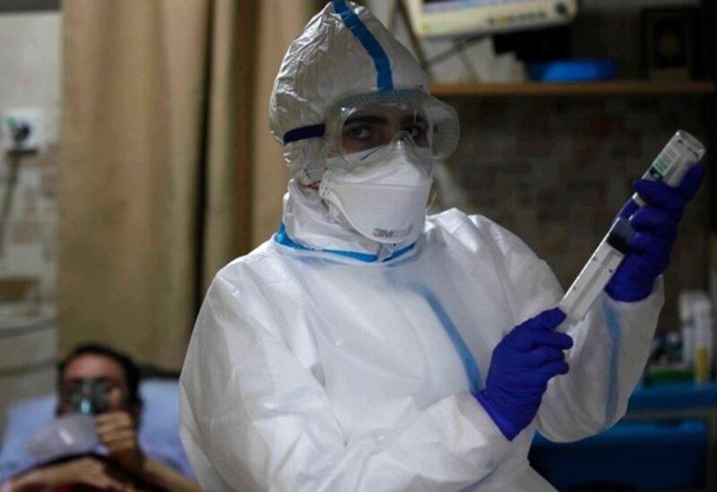A nurse attends to COVID-19 patients at Al-Hamshari Hospital in Sidon, Feb. 8, 2021.