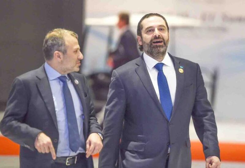 A picture showing Free Patriotic Movement leader Gebran Bassil (left) standing next to Prime Minister-designate Saad Hariri (right)