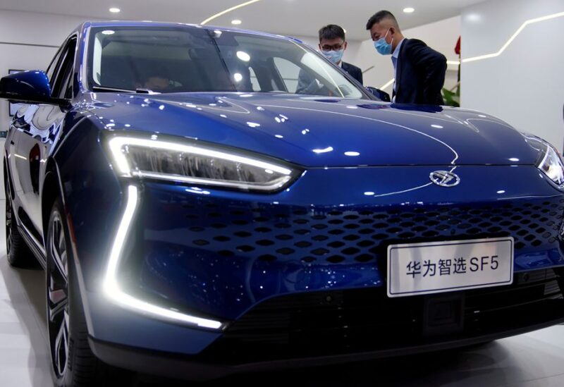 People check a Seres Huawei Smart Selection SF5 electric vehicle (EV) displayed during the Auto Shanghai show in Shanghai, China April 19, 2021. REUTERS