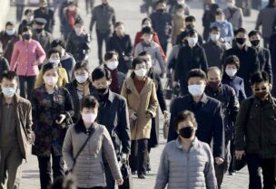 FILE PHOTO: People wearing protective face masks commute amid concerns over the new coronavirus disease (COVID-19) in Pyongyang, North Korea March 30, 2020, in this photo released by Kyodo. Mandatory credit Kyodo/via REUTERS