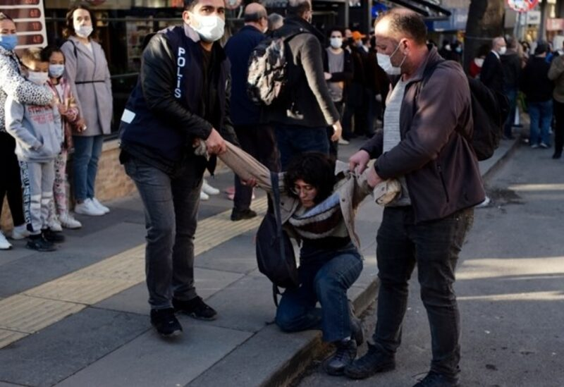 Riot police officers detain a student during a protest, in Ankara, Turkey, Friday, Feb. 5, 2021.